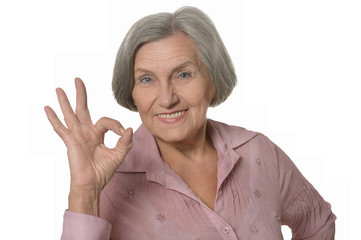Elderly woman showing sign of ok