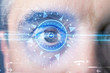 Cyber man with technolgy eye looking into blue iris