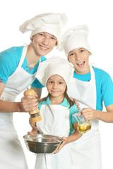Children in chef uniforms