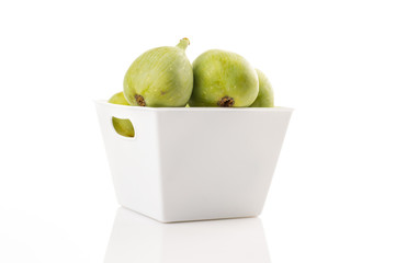 Ficus carica in bowl, fig fruit on white isolated background