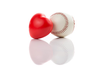 Baseball with red heart on white isolated background