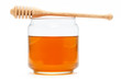 Obrazy na płótnie, fototapety, zdjęcia, fotoobrazy drukowane : Honey in jar with dipper on isolated background