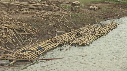 Floats with bamboo canes tied on the mekong river.
