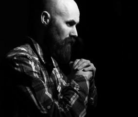 bearded man praying