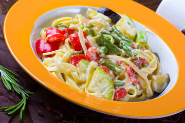 Italian vegetarian pasta with sauce and vegetables