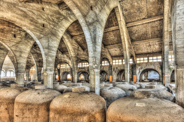 Concrete fermentation tanks in an abandoned cellar