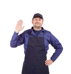 Worker wearing black apron.