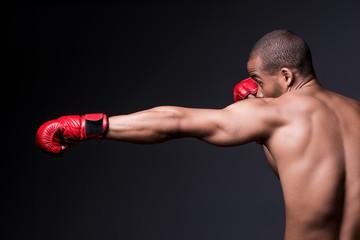 Training his boxing skills.