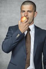 businessman eats vitamins