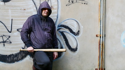 Aggressive man with a baseball bat at outdoor