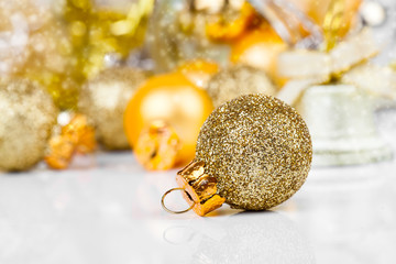 Red christmas ornaments with golden christmas bauble