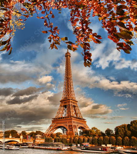 Eiffel Tower with boat on Seine in Paris, France