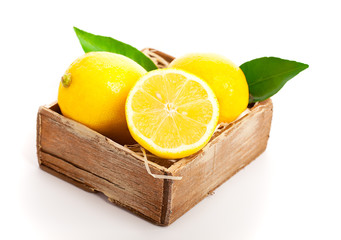 Wooden box full of lemons
