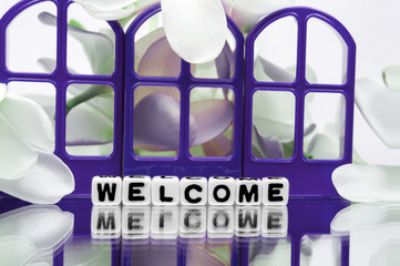 Welcome with purple gates and flowers