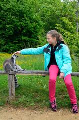 A girl near the tame lemur