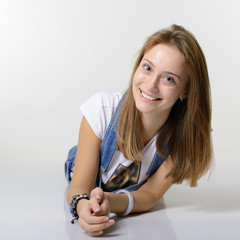 Portrait of attractive girl lying down and happy smiling looking