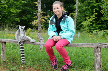A girl near the tame lemur