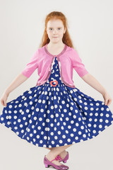 Pretty and Artistic Caucasian Redhaired Girl Posing in Polkadott