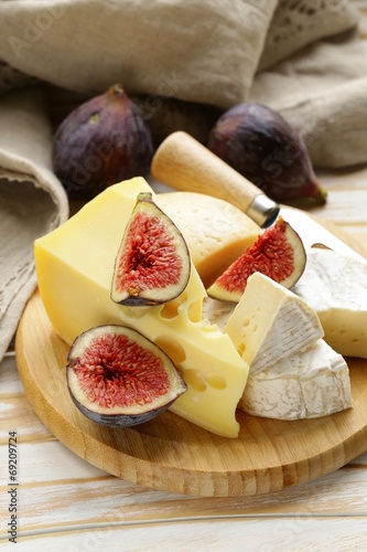 cheeseboard with maasdam, camembert, cheddar cheese and figs - 69209724