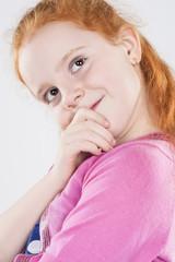 Closeup Portrait of Caucasian Beautiful Curious Redhaired Little
