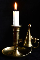 candle in brass candleholder