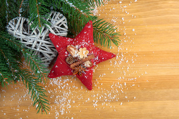 stitched red Christmas star with spices, with decoration, on woo