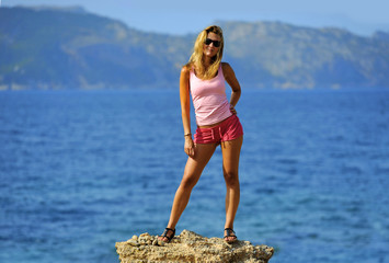 attractive woman feeling free in front of the sea