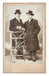 vintage studio photo from two young fashion men. antique picture