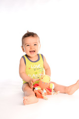 isolated studio portrait of lovely toddler baby boy playing