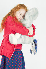 Happy Little Girl with Red Hair Playing with Big Toy