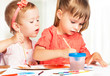 happy little girl in kindergarten draw paints