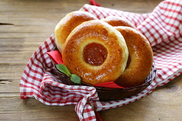 round sweet buns with apple jam in a wicker basket