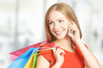 happy woman with  bags on shopping, talking on phone