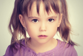 little beautiful girl with sad eyes