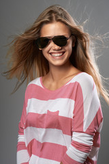 woman laughing with off sunglasses