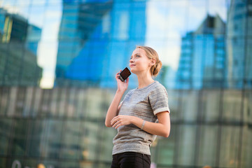 Confident business woman speaking on the phone