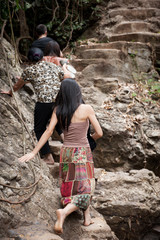 Unrecognizable people family at national park of Da Lat, Vietnam