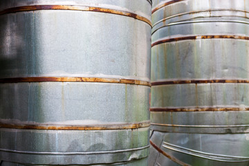 Close up of two vertical metal pipelines