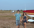 Little boy and little girl pilot with handmade plane