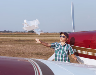 Little boy pilot with handmade plane