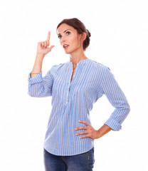 Wondering adult lady on blue blouse looking up