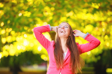 Fall season. Portrait laughing girl woman in park