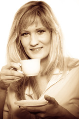 Mature woman drinking tea or coffee..