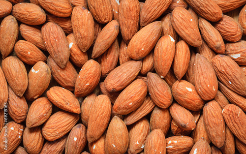 Almonds as food background © Voyagerix