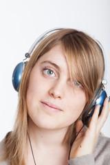 Beatiful girl listening music on headphones