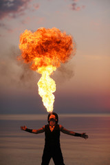 Fire performance solo; amazing fire-breathing
