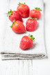 fresh strawberries on a white wooden table