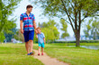 father and son communication, walking outdoors