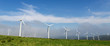 Wind farm in a green field - renewable energy - 69220592