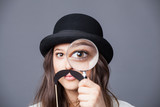 Detective woman with magnifying glass